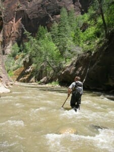 Man walking the Narrows in Zion National Park
